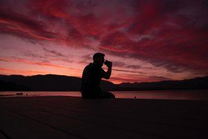 man overlooking sunset